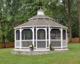 20' dodecagon white vinyl gazebo in backyard.