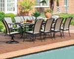 Madison outdoor dining set on a patio beside a pool.